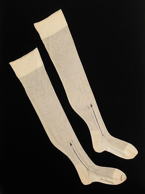 Details: Knit stockings made out of silk and cotton. From a Department Store in Little Rock, Arkansas. These types of stockings came into existence after the invention of the knitting frame and the circular-knitting machine. Stockings like these were popular until the late 1800s when hemlines rose.  Date: 1900