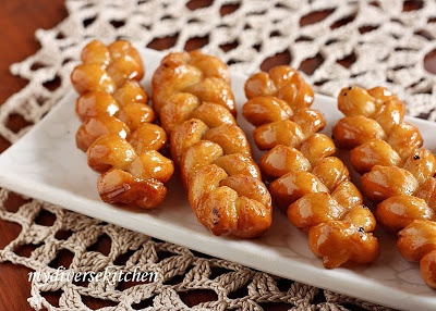 "Traditional South African recipe - ""Koeksisters"" - A koeksister (or koe'sister) derives from the Dutch word koekje, which translates to ""cookie"".It is a South African syrup-coated doughnut in a twisted or braided shape (like a plait). It is prepared by deep-frying plaited dough rolls in oil, then dipping the fried dough into cold sugar syrup. Koeksisters are very sticky and sweet and taste like honey."