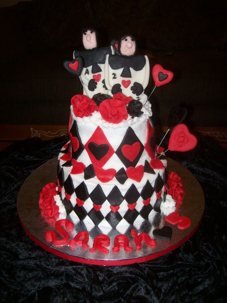 Hearts and Diamonds - This is a cake for a 5 yr olds birthday, her theme was Alice in wonderlands, Queen of Hearts, she wants to focus on the Card People :)  Buttercream frosting with Fondant Accents.