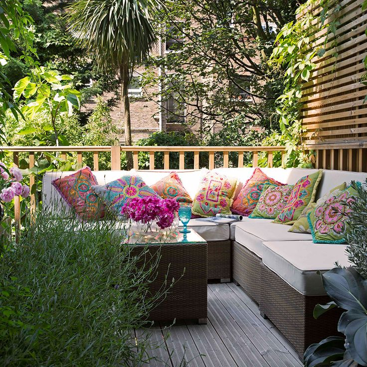 Take the comfort of your sofa out to the garden with rattan furniture and water-resistant seat pads. For a truly indoor-meets-outdoor approach to decorating your roof decking, add colourful cushions in a patchwork of bright patterns. There is a lot of vivid colour to be found in nature, so they won't look out of place against the vibrant greens of surrounding trees.