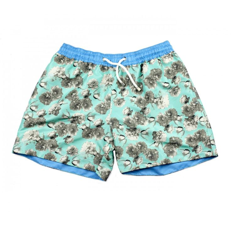 BORA BORA FLORAL SHORTS | When you think about the most iconic beach parties in the world, it won't be long before you come to Bora Bora, the legendary Ibiza hangout that has played host to some of the best parties of the last three decades. With this design, we pay homage to one of the cornerstones of clubbing culture. Shop the collection at thomasroyall.com