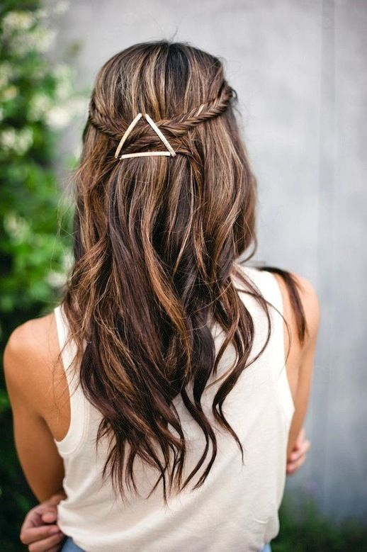 Long brown hair with subtle highlights.