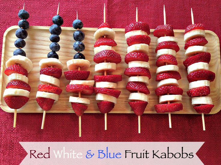 Red White Blue 4th of July Memorial Day Fruit Kabobs with strawberries blueberries and banana.