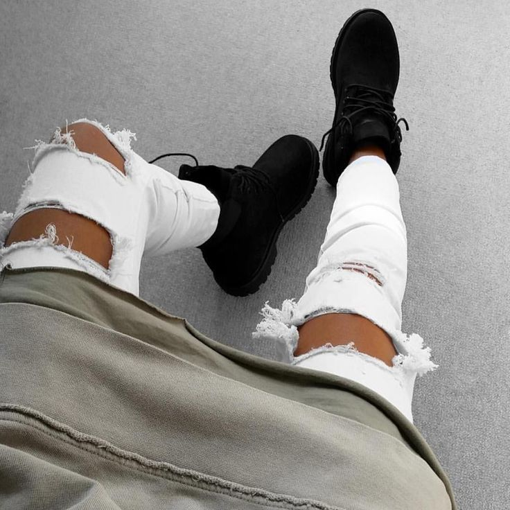 Black timberland boots, ripped jeans