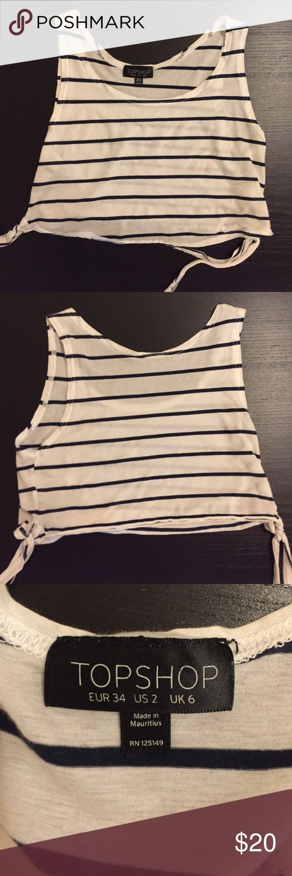 Topshop nautical crop top Navy and white striped crop top with tie embellishment on sides! Barely ever worn, like new condition Topshop Tops Crop Tops