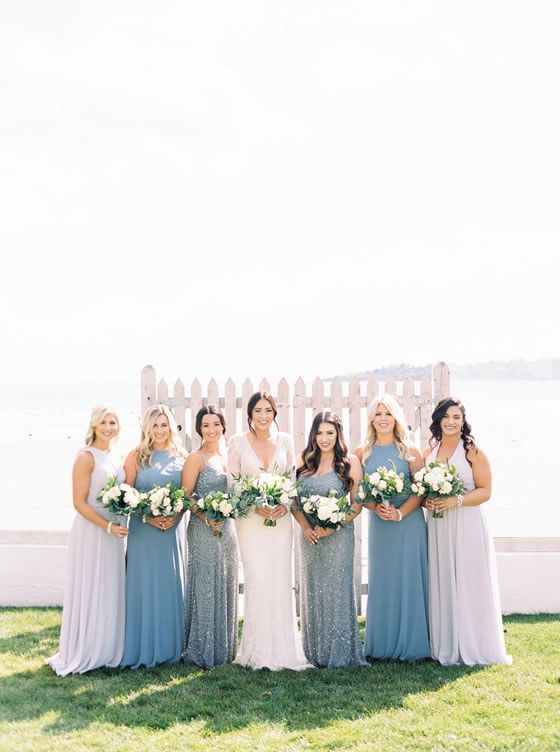 We love these mismatched blue bridesmaid gowns. Newport Beach House - A Longwood Venue Weddings Rhode Island Wedding Venue.