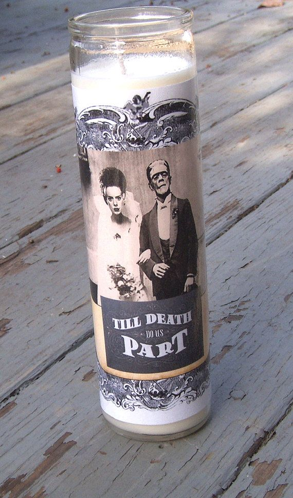FRANKENSTEIN BRIDE CANDLE  Til Death Do Us Part Candle in Glass Holder Depicting Classic Horror Movie Couple  SCENT: Vanilla  INGREDIENTS: Vegetable & Paraffin wax COLOR: White  MEASURES: 8 Inches Tall Ideal for Halloween Wedding or Spooky Decor