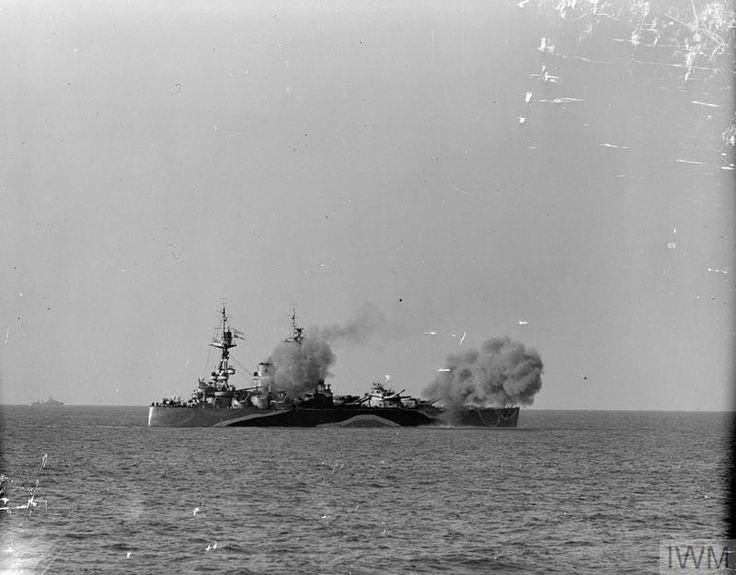 HMS RODNEY firing her 16-inch guns on to enemy positions ashore. | Royal navy ships. Navy ships. Battleship