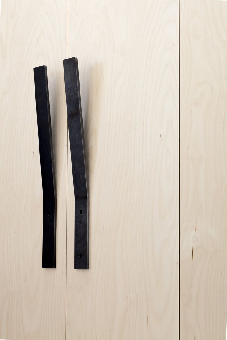 Black pull handles. Plywood House by Simon Astridge. #minimal
