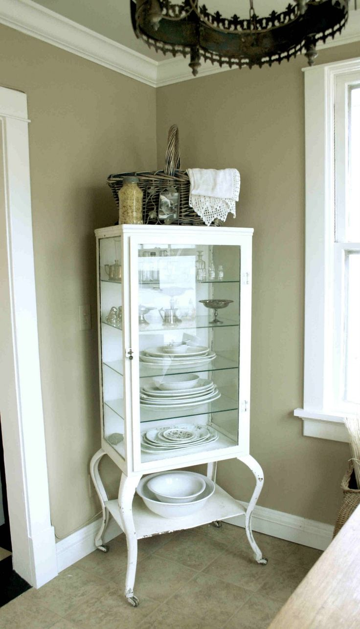 Old metal medical cabinet repurposed into a chic storage cabinet for dishes etc