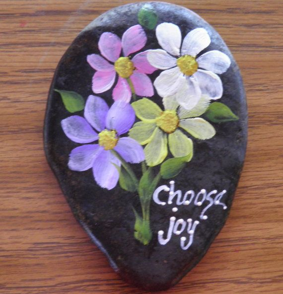 I love rocks! I am always hauling a bucket along when I swim, walk or wade in our many rivers and streams. This one is hand painted by me, using