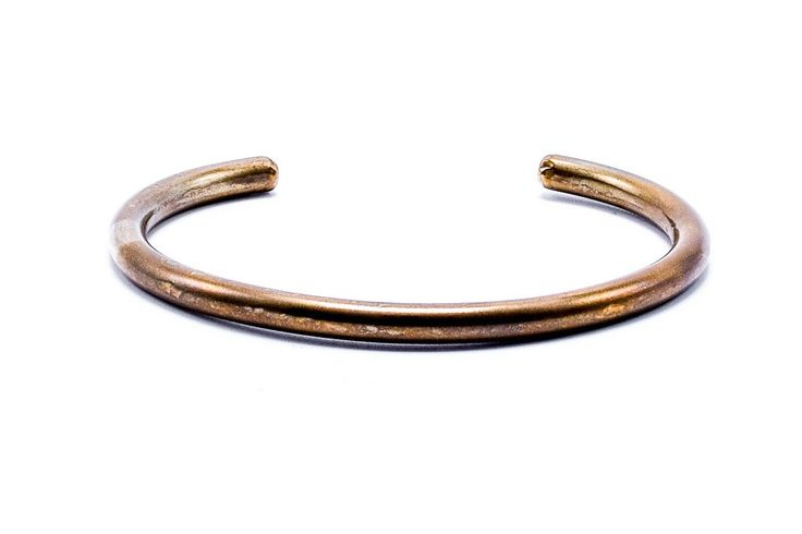"""Fortune Goods Montagnard Bracelet John Wayne Steel Copper Brass Mens Jewelry Bracelet Cuff $80 Coin Silver Bracelet Cuff $225 The John Wayne Bracelet was given to soldiers as a symbol of friendship and respect by the Montagnard tribe. We named this style of braclet (bearing no etching) after """"Duke"""" as he was given one by Montagnards during the filming of """"The Green Berets"""". Not only did Duke don the bracelet on his wrist until the day he passed, it's said he lays with it to this day."""