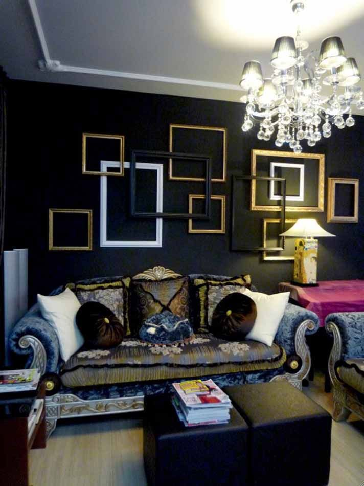 For a modern look, paint a black wall and hang white and gold frames for a sleek decorating look  RDNY.com - No Fee Apartment Rentals in NYC.