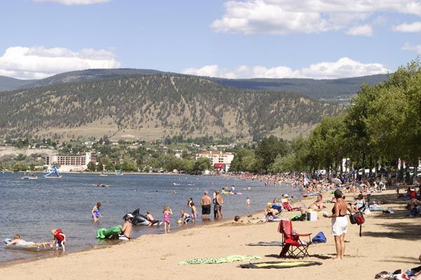 Okanagan Lake Beach. The city of Penticton in BC's semi-arid Okanagan Valley is sandwiched between two lakes and has seven public beaches to choose from. We like Okanagan Lake Beach especially for its gorgeous views of the surrounding hills. But be sure to check out the Skaha Lake beaches at the south end of town, too. Bonus: you can swim and sunbathe in the morning, tour wineries in the afternoon!