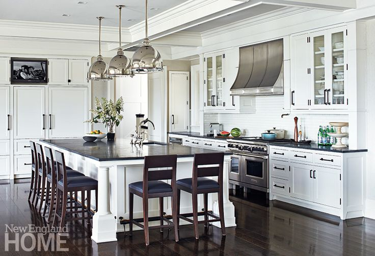 White cabinets dark hardware stainless appliances wood for Huge kitchen designs