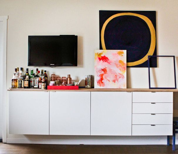 Mounted standard cabinetry units from Ikea float below the TV