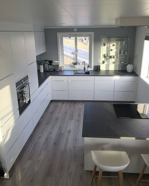 I like the White cupboards with grey walls and dar…