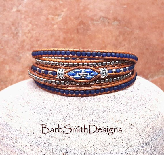The Skinny Mini 5-Wrap in Cobalt n Nickel  This Skinny Mini is surrounded with four (4) more skinny wraps to keep her company! It is designed with Opaque Picasso Blue Super Duo beads, surrounded by rows of small 8/0 seed beads in Frosted Cobalt glass and Nickel Oxide. It is accented