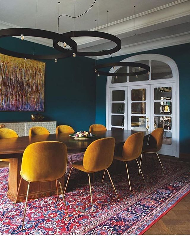 We Love The Mustard Yellow On These Iconic Gubiofficial Chairs Plus The Teal Wall And The Rug Perfection Yellow Dining Chairs Dining Room Teal Teal Rooms