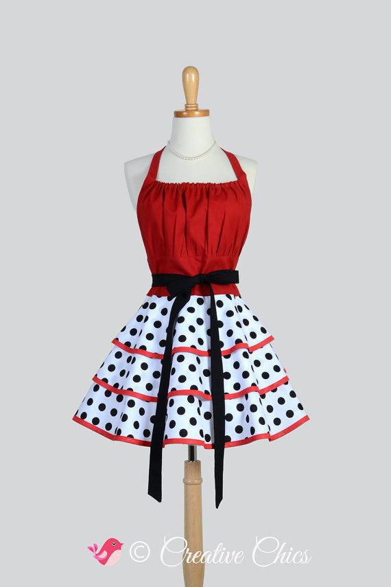 The flirty chic pinup apron features a full three-layered skirt in a black and white dots, dots measure 3/4. A full ruffled skirt and an extra-wide