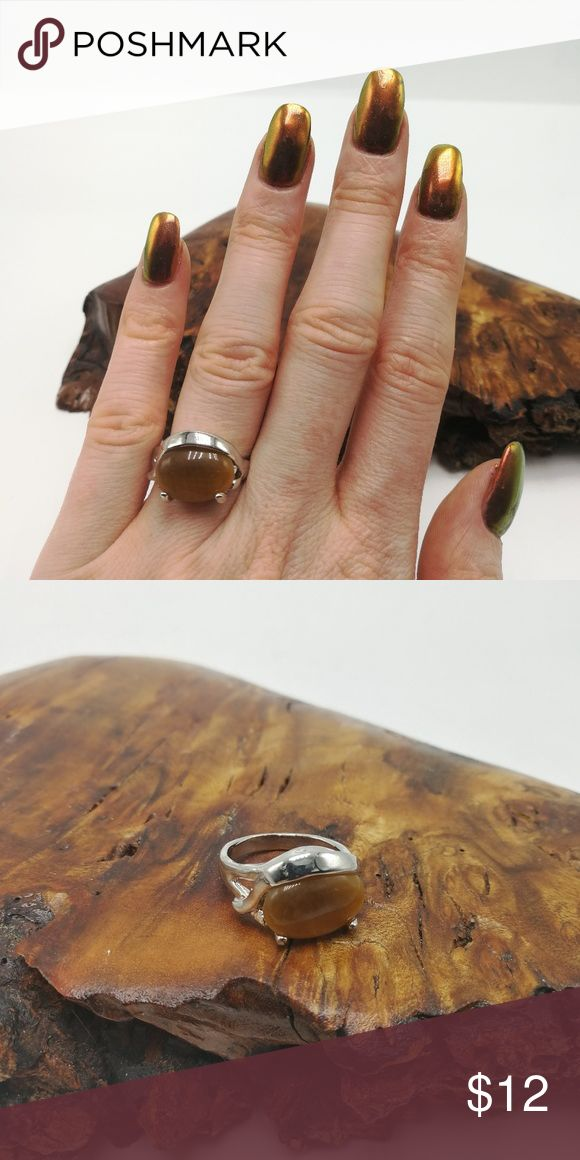 Tiger's Eye wood fossil brown gemstone oval New with Tags. Gorgeous Natural Gemstone Silver High Quality Electro-Plated ring. No trades or holds. Price is firm. Bundle to SAVE.   R#4000 ooak dainty Crystal tiger's Eye wood fossil oval urban outfitters Jewelry Rings