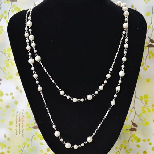 Pearls and Chains Layered Necklace | You can never have two many pearls, and this DIY necklace is perfect proof that you need more!