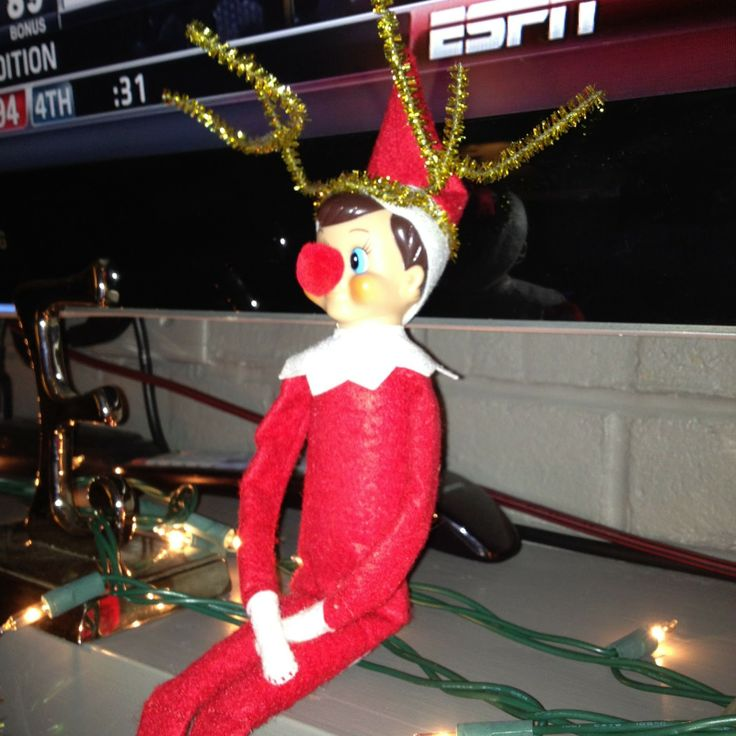 elf dressed as rudolph