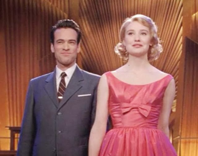 """1950s style Coral silk dress worn by Déborah François in """"Populaire"""" seen here with Romain Duris as her leading man"""