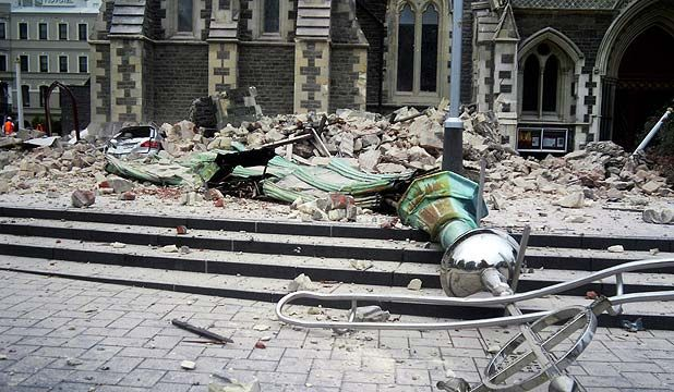 ChristChurch Cathedral's spire lying amid the ruins Canterbury and Christchurch earthquakes on 22 February 2011