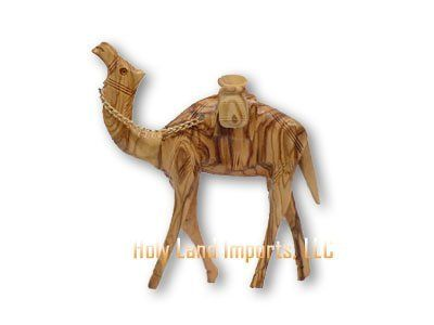 "Olive Wood Camel With Water Jars (6.25""H) by zytoon. $27.50. The rich color and interesting veins are characteristic of the beautiful Bethlehem Olive Wood.. This beautiful camel comes with water jars.. Approximate height about 6.25""H.. Add a special touch to your Nativity Set this year with Olive Wood Camels.. Beautiful detail. Add a special touch to your Nativity Set this year with Olive Wood Camels. This beautiful camel comes with water jars. The rich color and intere..."