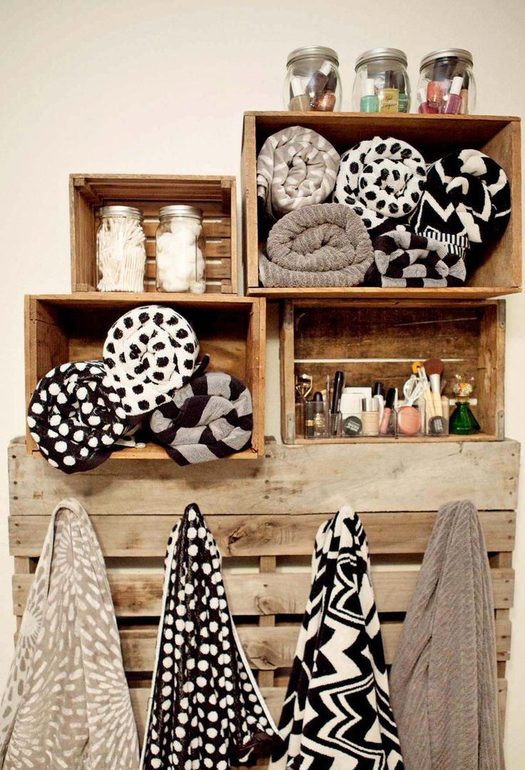 wood crates to store towels and bathroom items