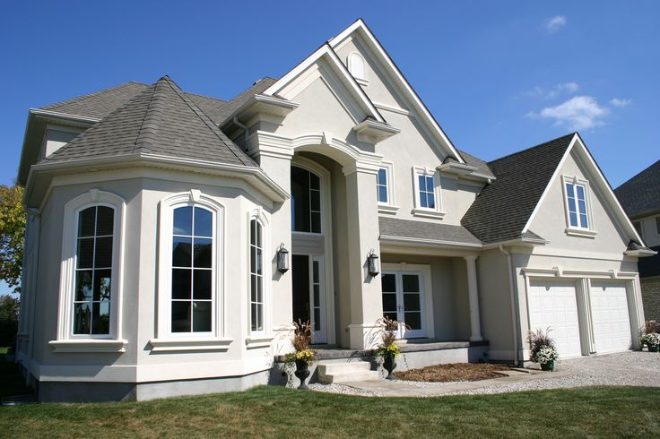 Large curve-top windows paired with casement windows