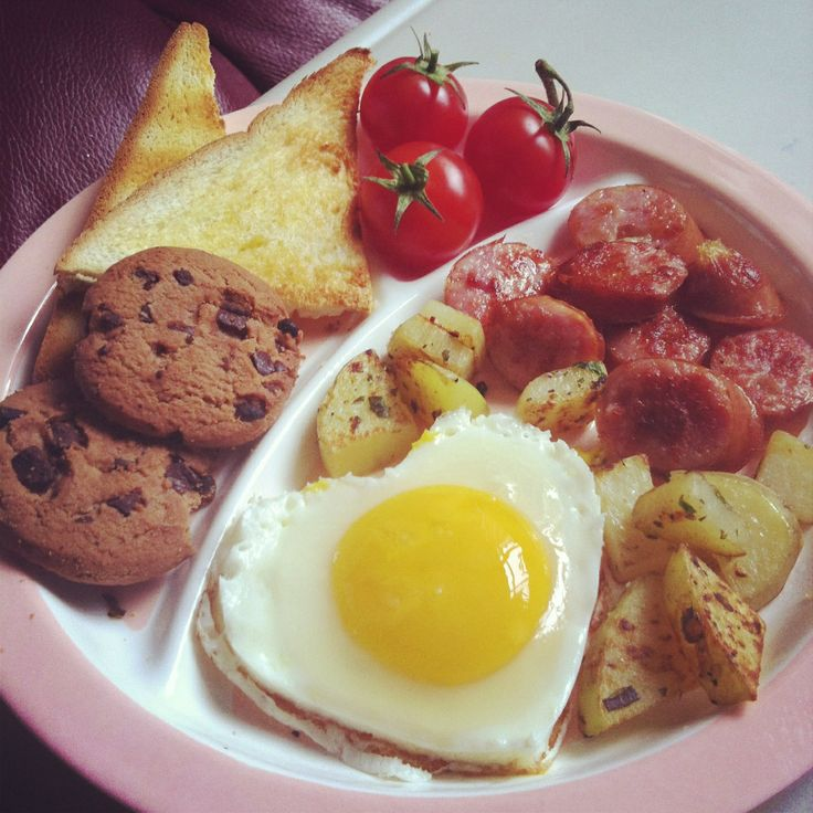 English breakfast with heart-shape egg