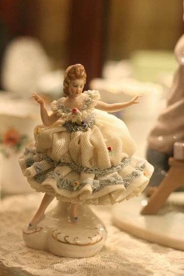*DRESDEN VOLTSTEDT:   porcelain, made in Thuringa, Germany. Company started by entrepreneur: Georg Heinrich Macheleid in 1760. TRIVIA:  the lace on these figurines is real lace, covered in liquid porcelain, when the piece is fired the lace desinagrates, leaving the lace look.