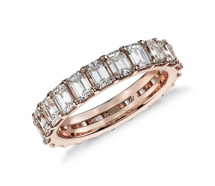 Exceptional elegance, this 3.50 ct. diamond eternity ring showcases perfectly matched emerald-cut diamonds set in 18k rose gold.