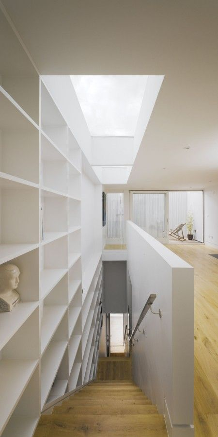such an effective trick here, the roof window just looks like a continuation of the book shelves. Plus the shelves are bathed in natural light.