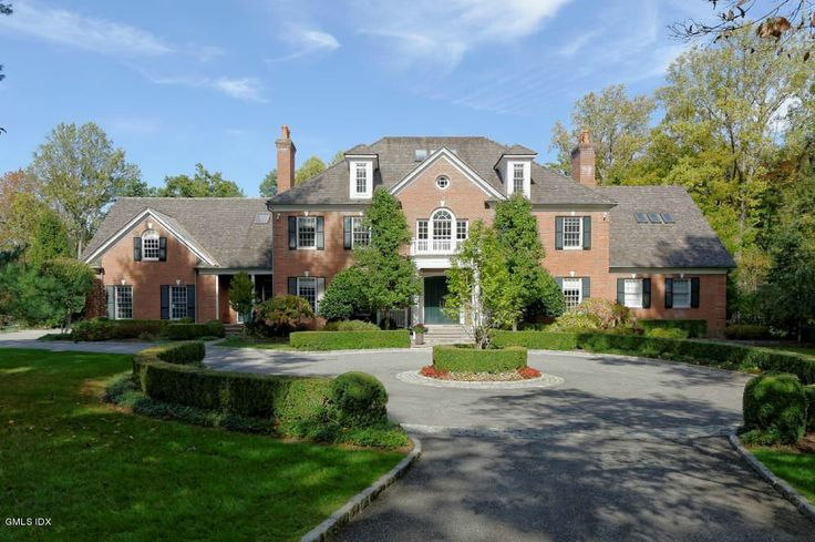 A classic greenwich ct home with majestic gardens and a
