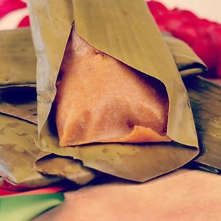 Conkies | 21 Delicious Foods From Barbados Everyone Should Know And Love    -What it is: Cooked by steam and wrapped in a banana leaf, conkies are a traditional Bajan dish. Corn flour mixed with coconut, spices, sugar, pumpkin, and the optional raisins or cherries make up this sweet treat. Originally, they were prepared on Guy Fawkes Day. Now, it's eaten any time but especially when celebrating Barbados' Independence Day.