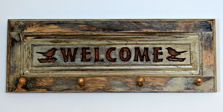 Rustic Cabinet door welcome sign/coat hanger made out of hickory cabinet doors. The welcome and birds are carved in with CNC router. The whole piece is finished with a 3-step finishing process to give it the weathered look. #WelcomeSign #CoatHanger #RusticDecor #HomeDecor #CountryDecor