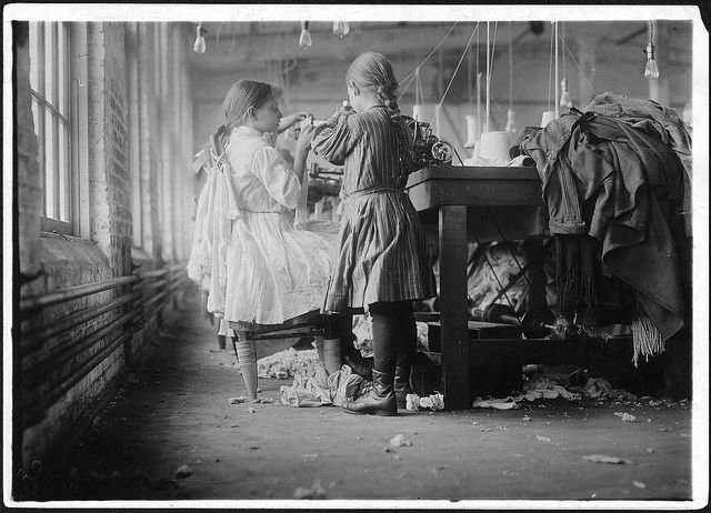 Lewis Hine's extraordinary photographic expose of child workers in the US in the early 20th Century. Two of the tiny workers, a raveler and a looper in London Hosiery Mills. London, Tenn, December 1910 by The U.S. National Archives, via Flickr