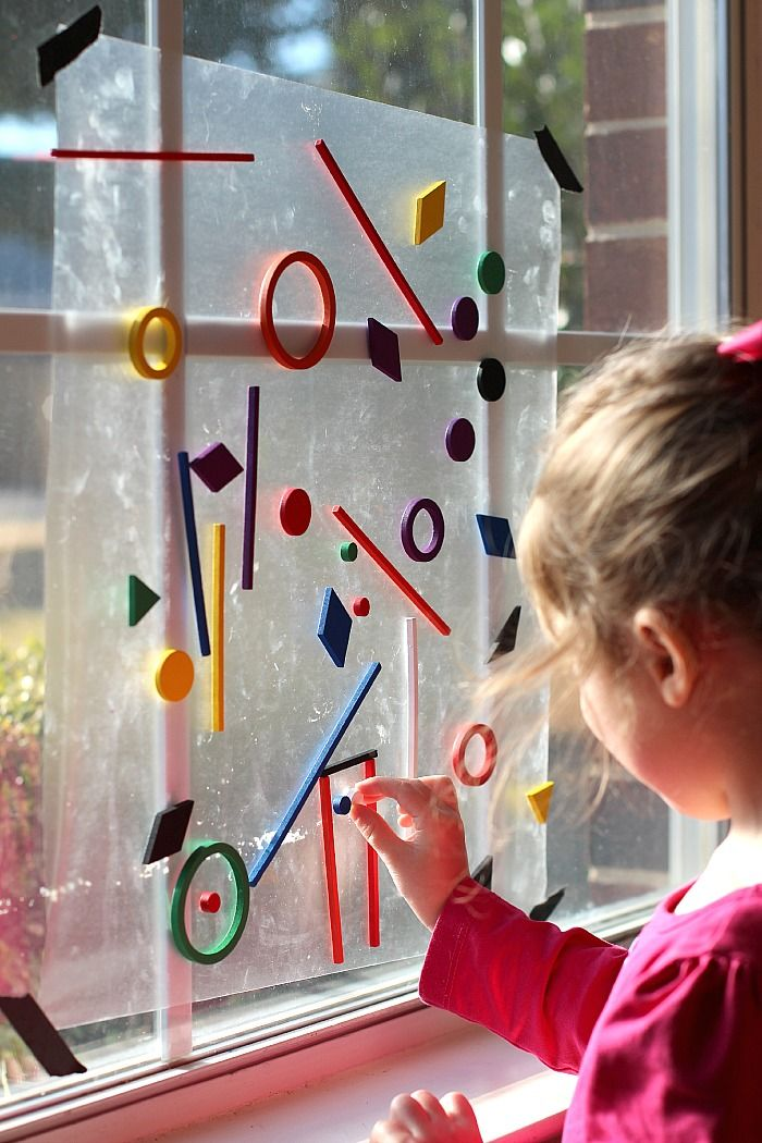 Loose parts, contact paper sticky side out, and a window. Perfect prvocation.