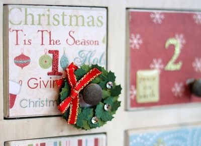 """Fill an Advent calendar with a """"build your own"""" sticker Christmas tree. Each day they got more sticker ornaments to add to their picture hanging on the fridge. Kids had more fun with that than the chocolate version!"""