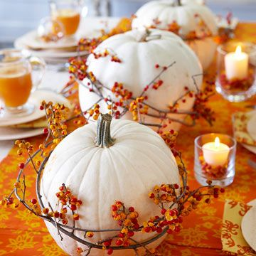 Wrapped White Pumpkins: Give white pumpkins colorful texture and flair. Here, long bittersweet berry vines wrap two or three times around medium-size gourds. Secure the ends with florist's wire.