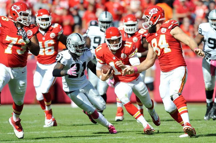Oakland cornerback Mike Jenkins tries to track down Kansas City quarterback Alex Smith. The Raiders couldn't keep up with the unbeaten Chiefs, who won 24-7. 10/13/13