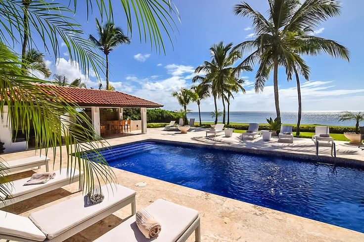 Costa Verde is a luxurious Spanish Mediterranean style home that has just been completely updated with beautiful garden showers, travertine floors throughout, and a wide open view of the Caribbean with full Glass bifold doors.