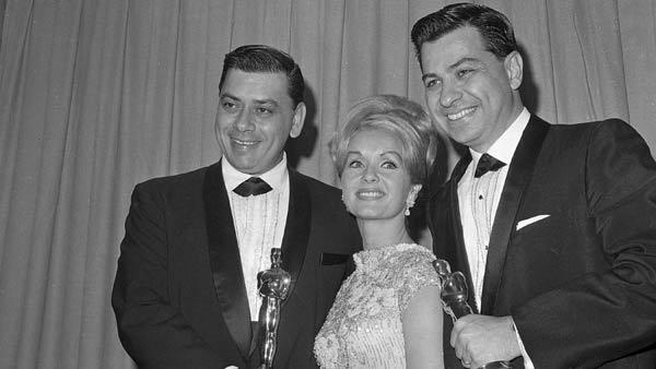 "Actress Debbie Reynolds, center, presented the award for Best Picture at the Academy Awards in Santa Monica, Calif., April 5, 1965 by Richard M. Sherman, right, and Robert Sherman, left, for the movie. ""Mary Poppins."" Robert Sherman, who wrote the tongue-twisting ""Supercalifragilisticexpialidocious"" and other enduring songs for Disney classics, died Tuesday, March 6, 2012 at the age of 86."