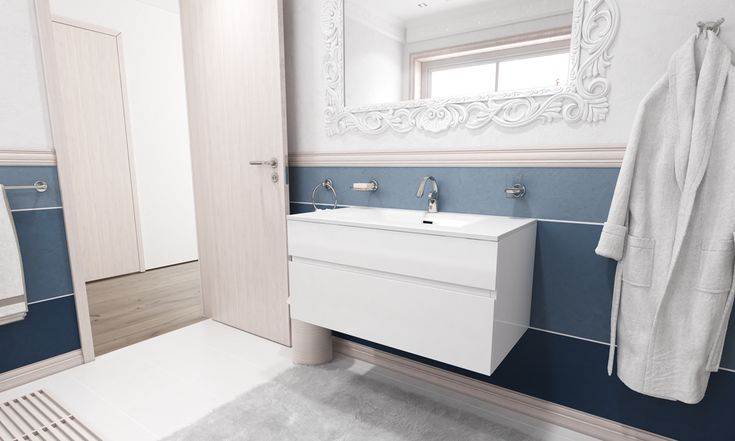 Bold horizontal lines in shades of blue contrast with the marble in the shower area, emphasizing the Victorian and Modernism styles, yet marrying them to form an elegant atmosphere. While an ornate mirror frame speaks the language of the Victorian style and imitates the shape of the cornices to form a vertical connection from the ceiling down.