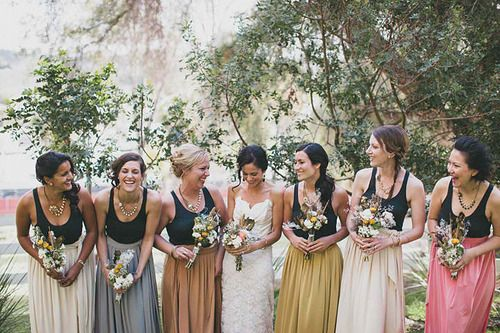 Love that all the bridesmaids dress tops are the same and the skirt is a different color! Perfect! Each girl can pick the color that best describes them :)