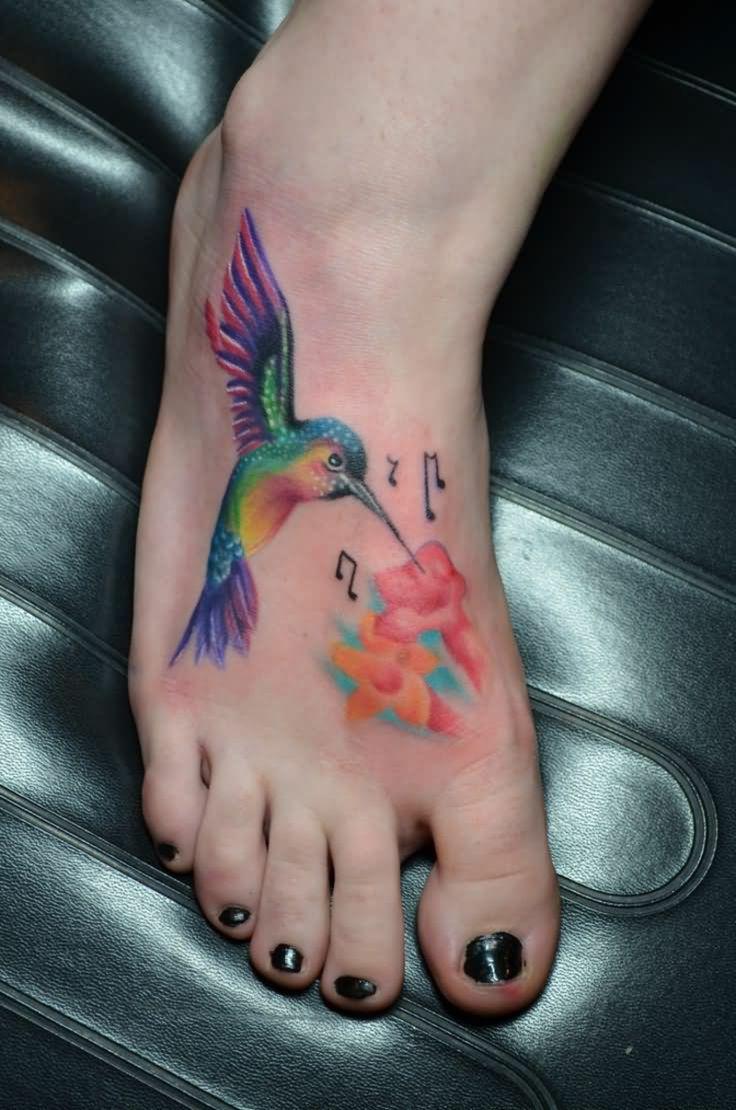 tattoo-kolibri-Colorful-Hummingbird-With-Flowers-And-Music-Knots-Tattoo-On-Girl-Foot-resized