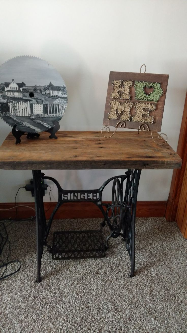 Sewing machine table base with barn board table top.